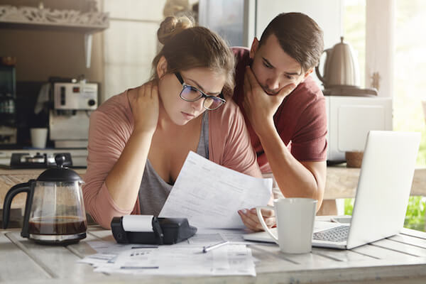 Couple worrying over a bad credit rating