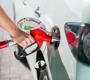 Driver filling a car with fuel