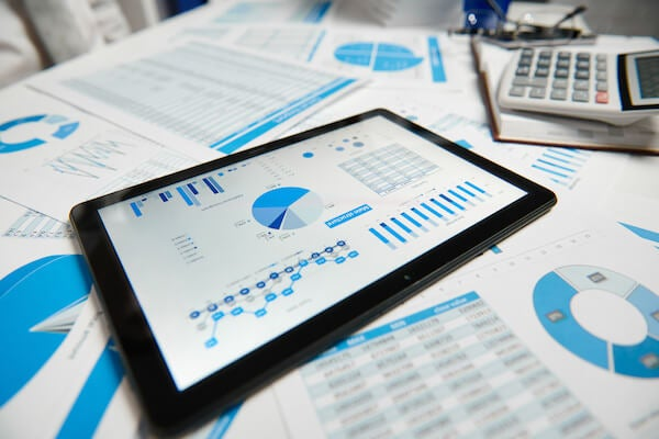 Tablet displaying analytical CRM software at work