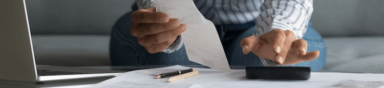 Close up of a businesswoman reconciling invoices