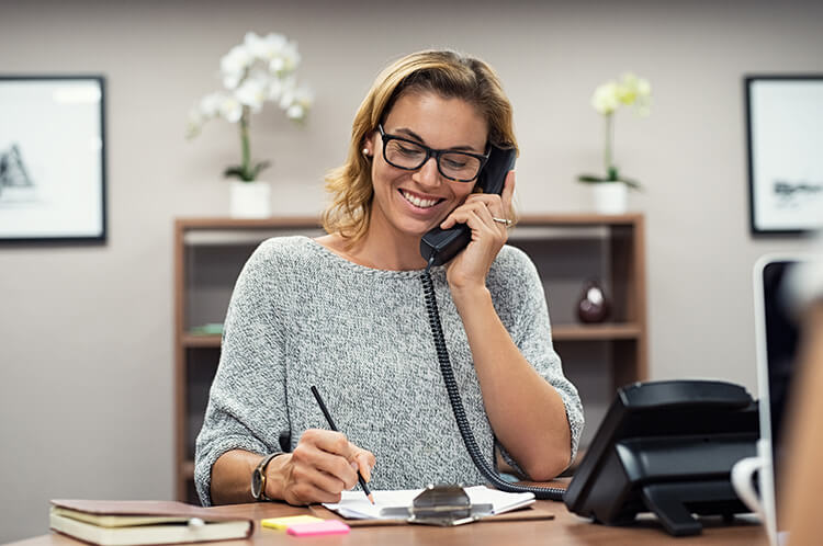 Entrepreneur speaking on the phone and smiling