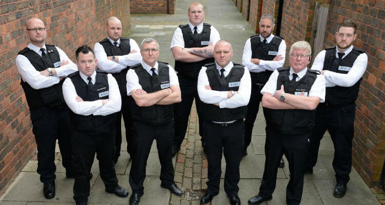 DCBL team standing in an alleyway with their arms folded