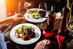 Restaurant customers with food and wine