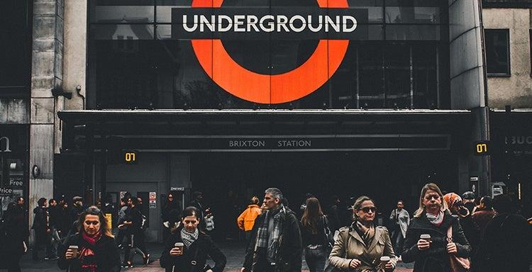 Commuters outside Brixton underground station