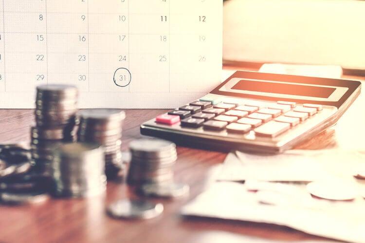 Calculator, coins and a calendar