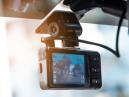 Dash cam attached to a car interior mirror