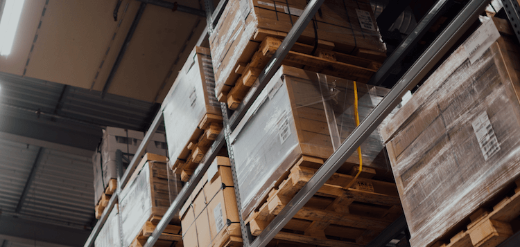 Large wooden storage boxes within a fulfilment centre