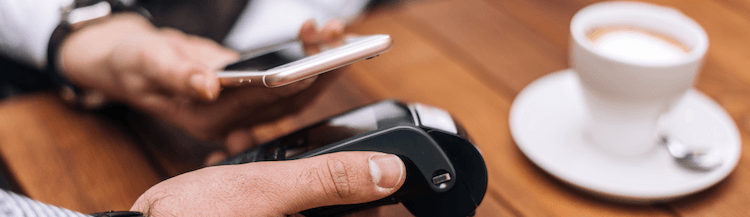Consumer paying for coffee with a mobile device