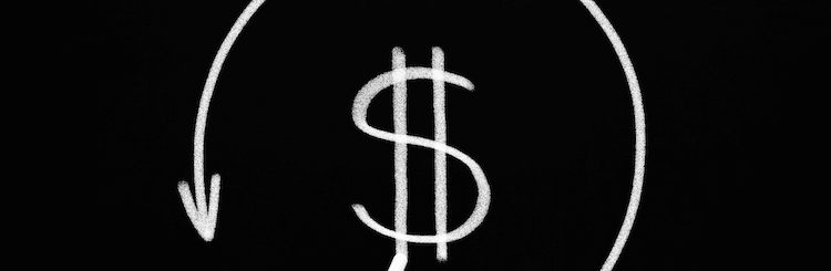 Hand drawing a dollar sign and circular arrow on a blackboard to represent chargebacks
