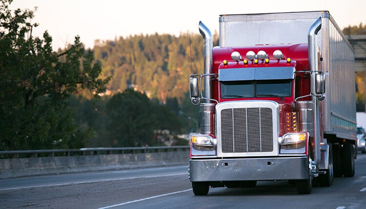 Truck driving along a road