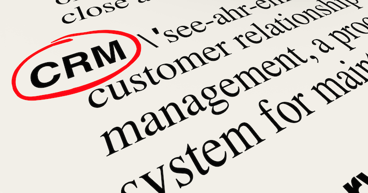 The letters CRM, circled in red pen in a page of the dictionary