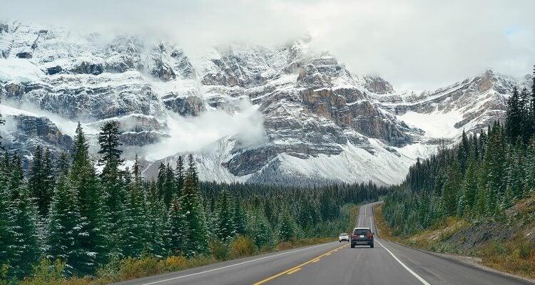 A road leading into a mountainous landscape