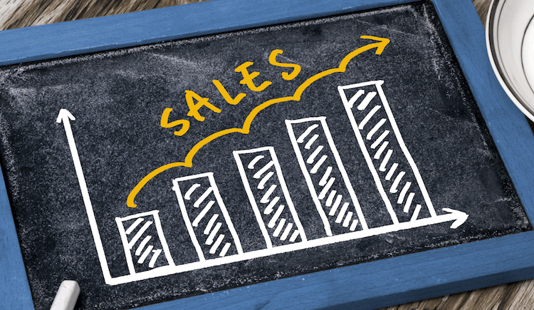 Drawing of increasing sales on a chalkboard