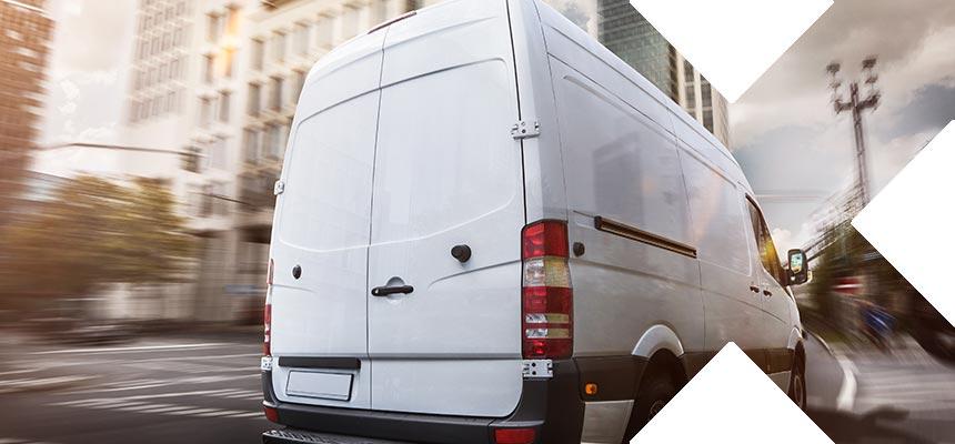 A van driving along an urban road