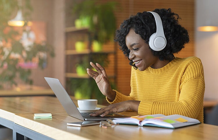 Woman communicating with her team remotely