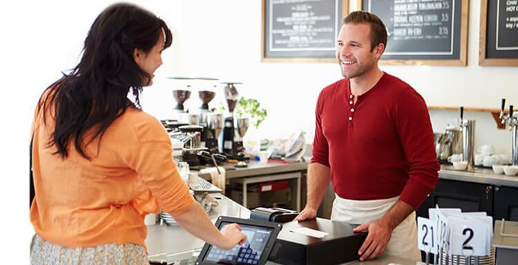 Cafe customer using an EPOS till