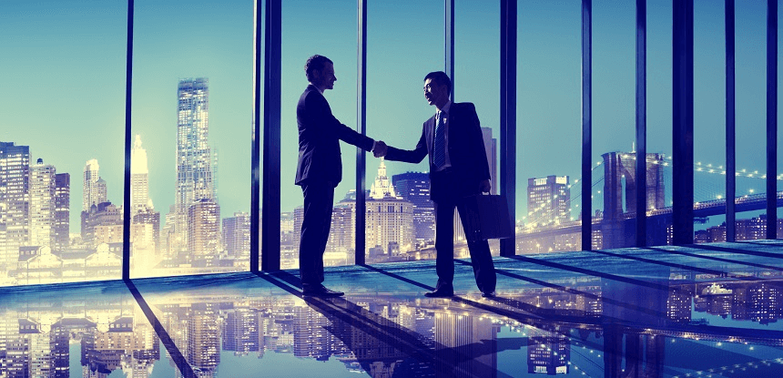 Businessmen shaking hands in New York